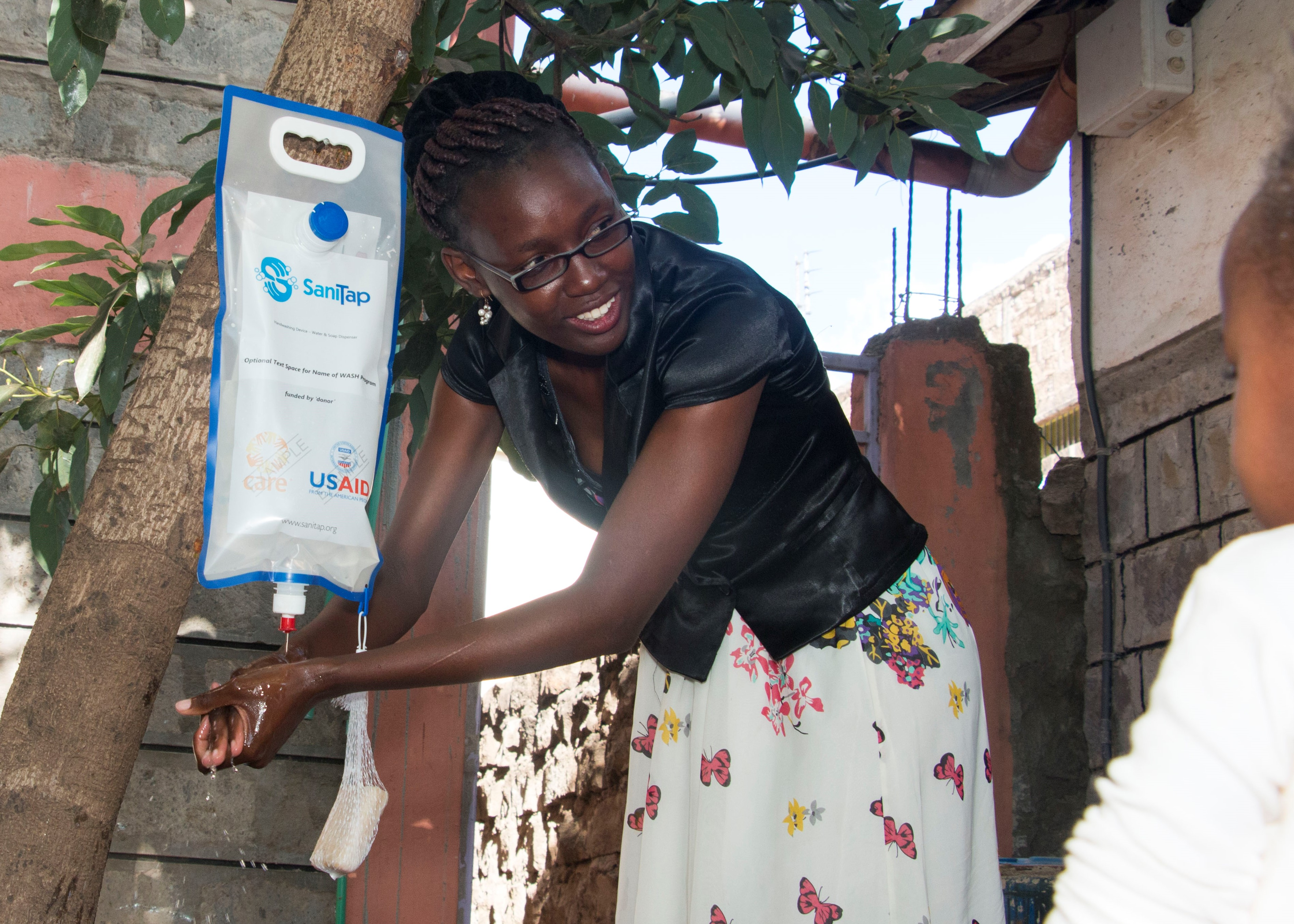 SaniTap - a handwashing device that helps reduce the spread of COVID-19 in developing countries / refugee and IDP camps
